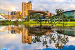 Adelaide city skyline viewed across Torrens river. Adelaide,  Australia - August 27, 2017: Adelaide city skyline reflected in Torrens river in Elder Park at Stock Photography