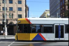 Adelaide city tram in blurry motion. Adelaide Metro provides a free tram service in Adelaide the capital city of South Australia stock images