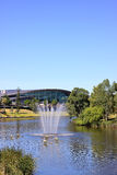 Adelaide Convention Centre, Australia. Adelaide Convention Centre along the banks of the River Torrens Lake, with a water fountain and 'paper boats' sculpture in Royalty Free Stock Images
