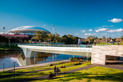 Adelaide Oval and foot bridge. Adelaide, Australia - September 11, 2016: Adelaide Oval and foot bridge viewed across Elder Park on a bright day Stock Image