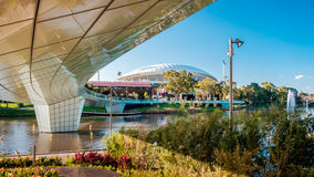 Adelaide Oval and foot bridge. Adelaide, Australia - September 11, 2016: Adelaide Oval and foot bridge viewed across Elder Park on a bright day Royalty Free Stock Image