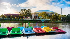 Adelaide Oval and Torrens river. Adelaide, Australia - August 27, 2017: Adelaide Oval viewed across Torrens river in Elder Park at sunset Royalty Free Stock Photo