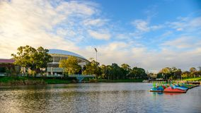 Adelaide Oval and Torrens river. Adelaide, Australia - August 27, 2017: Adelaide Oval viewed across Torrens river in Elder Park at sunset Stock Photography