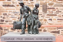 Migrant statue in Adelaide, Australia. Adelaide SA, Australia - November 20, 2009: Black bronze statue of migrants show husband and wife with one child, all Royalty Free Stock Photography