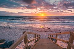 Adelaide shores beach at sunset. Vibrant dramatic sunset at West Beach, Adelaide shores, South Australia royalty free stock photography