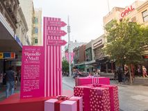 Pink gift boxes for decoration at the main entrance of Rundle Mall, for coming Christmas season. stock photos