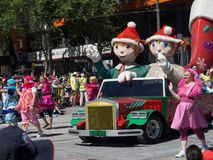 Fantasy floats ` Christmas Fairy Elves ` perform in the 2018 Credit Union Christmas Pageant parade. stock photos
