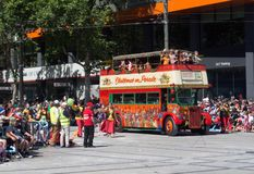 Fantasy floats ` London bus ` perform in the 2018 Credit Union Christmas Pageant parade. ADELAIDE, SOUTH AUSTRALIA. - On November 10, 2018. – Fantasy royalty free stock images