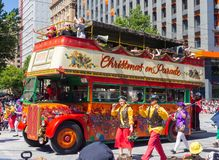 Fantasy floats ` London bus ` perform in the 2018 Credit Union Christmas Pageant parade. royalty free stock image