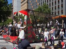 Fantasy floats ` Skateboarding ground in the steel cage ` perform in the 2018 Credit Union Christmas Pageant parade. royalty free stock photography