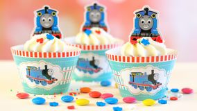 Children`s birthday party Thomas the Tank Engine themed cupcakes. Adelaide, South Adelaide - June 15, 2018: Children`s birthday party Thomas the Tank Engine Stock Photo