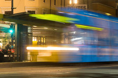 Adelaide tram at night. Adelaide, Australia - 22 June, 2016: A tram makes a temporary stop in King William Street before continuing it's journey to the Stock Photo