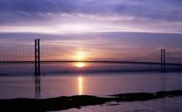 Adelante puente del camino en la puesta del sol Fotografía de archivo
