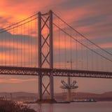 Adelante puente del camino en la puesta del sol Fotos de archivo libres de regalías