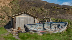 A adelic boat house with old boat. Outside Royalty Free Stock Photo
