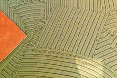 Adesivo da telha em uma parede fotografia de stock royalty free