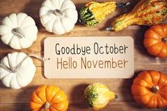 Adeus mensagem de outubro olá! novembro com coleção o fotos de stock