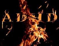 Adhd-Buchstaben auf einem Feuerhintergrund Stockfoto