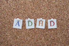ADHD letters pinned to a cork notice board Stock Photography