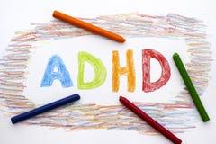 ADHD som är skriftlig på arket av papper royaltyfria foton