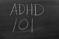 ADHD 101 sur un tableau noir Images libres de droits