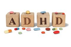 ADHD on wooden blocks. Wooden blocks with letters ADHD and pills Royalty Free Stock Photos