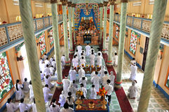 Adherents to Cao Dai religion praying in Vietnam Stock Images