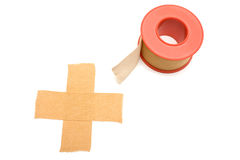 Adhesive. One isolated cross made of medical adhesive Royalty Free Stock Photos