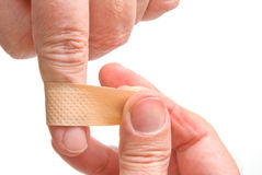Adhesive Bandage. A person applying an adhesive bandage to a wound royalty free stock photography