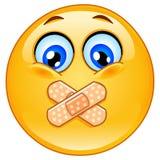 Adhesive bandage emoticon. Emoticon with adhesive bandages over his lips Royalty Free Stock Image
