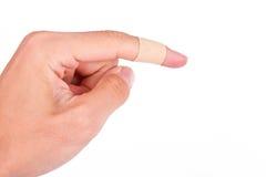 Adhesive Bandage on Index Finger Stock Photos