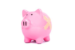 Adhesive Bandage on Piggy Bank Royalty Free Stock Photos