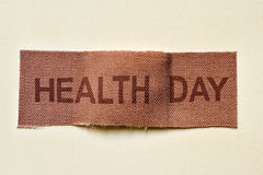 Adhesive bandage with the text health day Stock Images