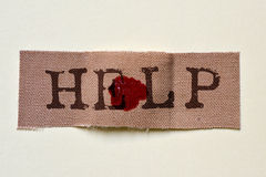 Adhesive bandage with the text help Stock Image