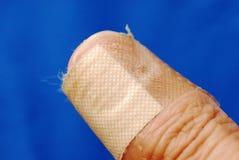 Adhesive bandage on the thumb Royalty Free Stock Image