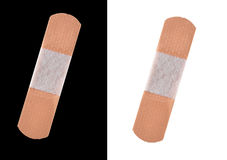 Adhesive bandages isolated on black and white Royalty Free Stock Photography