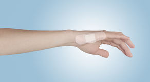 Adhesive Healing plaster on finger. Royalty Free Stock Photo