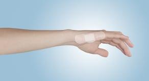 Adhesive Healing plaster on finger. Royalty Free Stock Photo