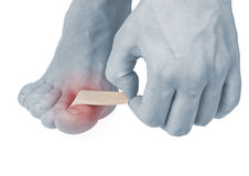 Adhesive Healing plaster on foot finger. Royalty Free Stock Photos