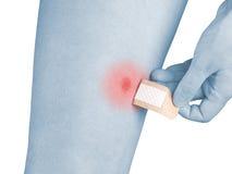 Adhesive Healing plaster on leg. Stock Image