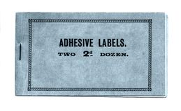 Adhesive labels. An old book of adhesive labels isolated on a white background Royalty Free Stock Images