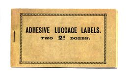 Adhesive luggage labels. An old book of adhesive luggage labels isolated on a white background Stock Photo