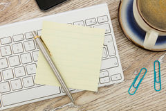Adhesive note on desk Stock Image