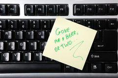 Adhesive Note on keyboard. Gone for a beer or two Stock Photo