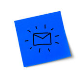 Adhesive note with mail symbol Stock Images