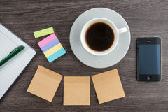 Adhesive Note, notebook and smart phone with coffee Stock Photography