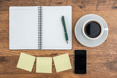 Adhesive Note, notebook and smart phone with coffee Royalty Free Stock Image