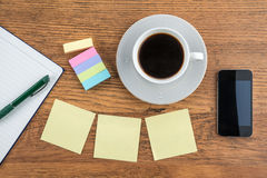 Adhesive Note, notebook and smart phone with coffee Royalty Free Stock Images