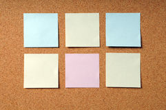 Adhesive Note Pads on Cork Board Stock Image