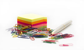 Adhesive note paper, with paperclips and pen Stock Images
